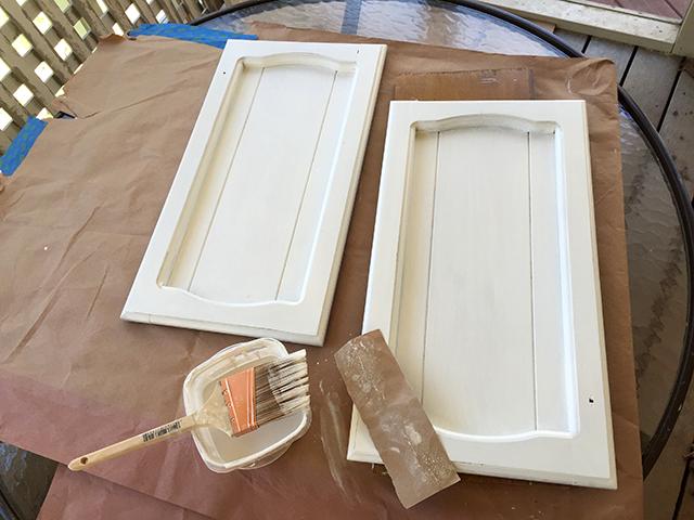 painting-cabinet-doors-a-light-sanding-between-coats