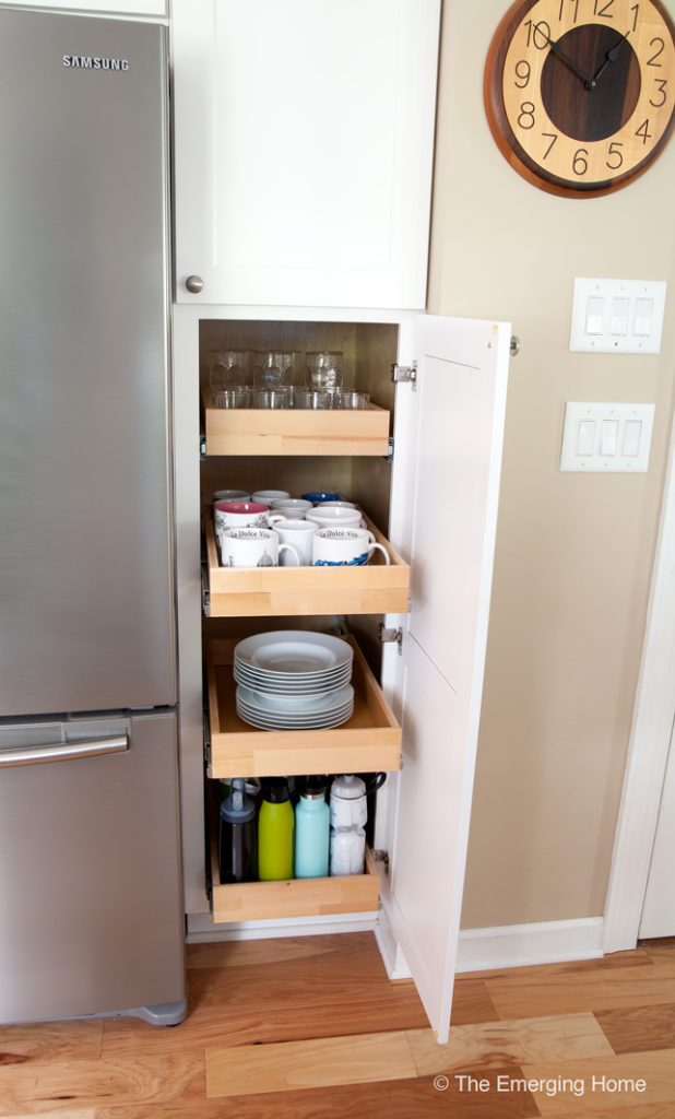 Open cabinet showing drawers that pull out to access the deep cabinet space.