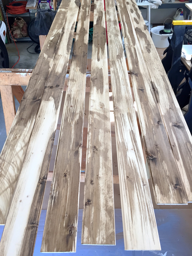 Seven, 8 foot planks have stain on them and are ready for the whitewash top coat