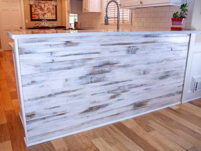 Completed family room bar with strong white and dark brown distressed patches on wood planks