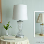 Updated crystal and silver lamp with drum shaped shade contrasts with original brass lamp with pleated shade.