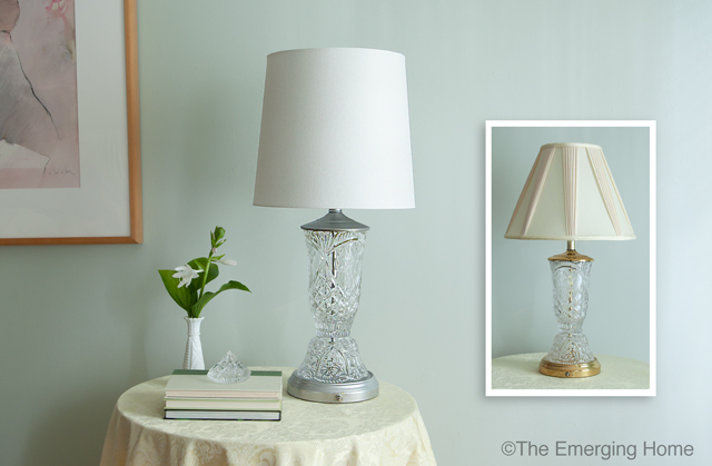 Updated crystal and glass table lamp with white drum shade sits on small table