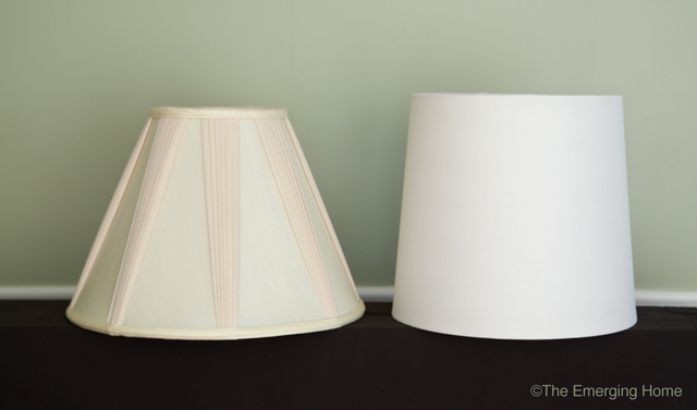 a pleated, cream colored, bell shaped lampshade sits beside a white drum drum shaped lampshade