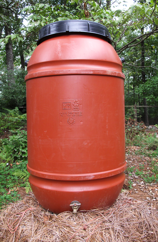 dark orange 58-gallon water barrel