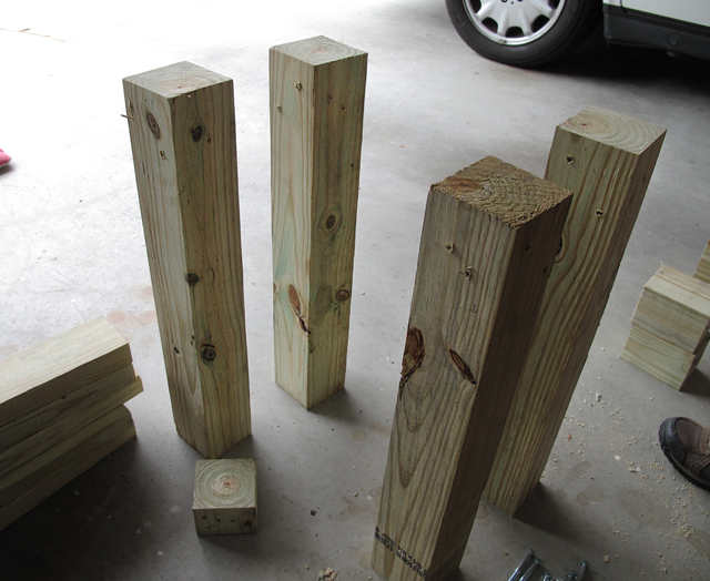 4 legs of rain barrel stand have been pre-drilled and are standing upright