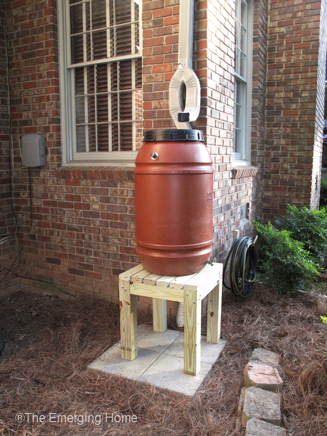 completed rain barrel including downspout diverter and water barrel stand