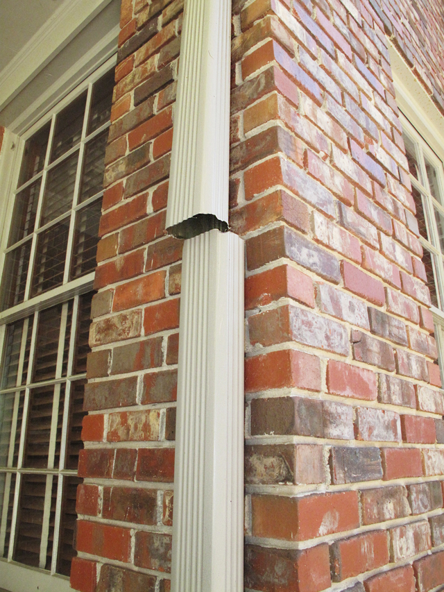 Photo shows the completed top cut of the downspout in preparation to install the downspout diverter