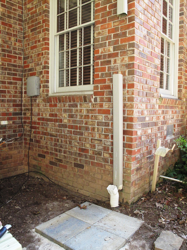 Shows the empty space between the top cut and bottom cut. Downspout is now ready to insert the diverter.