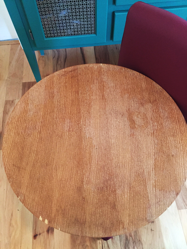 sanding is completed on tabletop. Light and dark areas remain indicating water stains