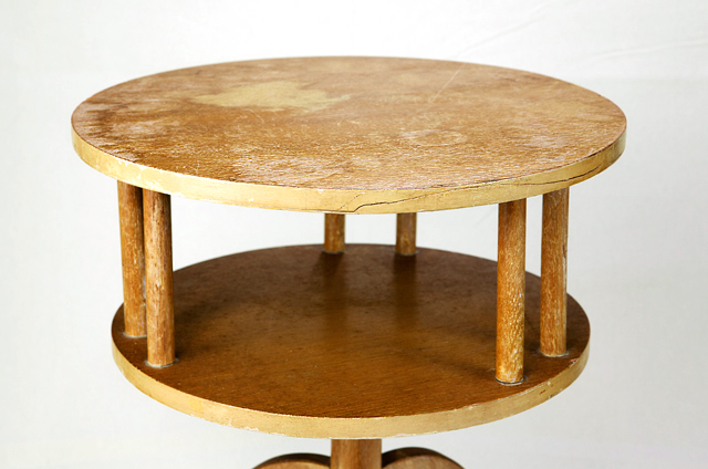 two level mid-century modern table in need of refinishing