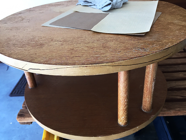 veneer around the top level of table shows a long crack