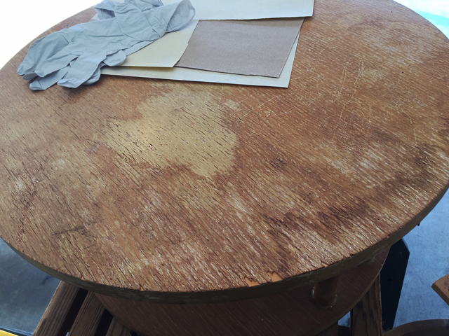tabletop shows light and dark ragged stains indicating water damage