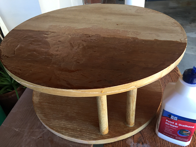 Gel stripper spread on one side of mid-century modern side table