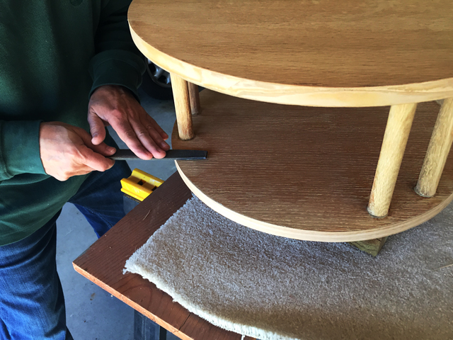 Using a fine file to smooth off the cut veneer edging