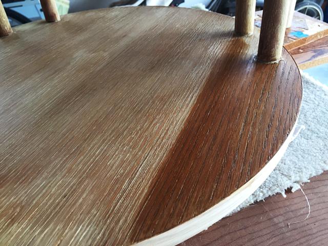 Oak stain applied to a portion of lower shelf