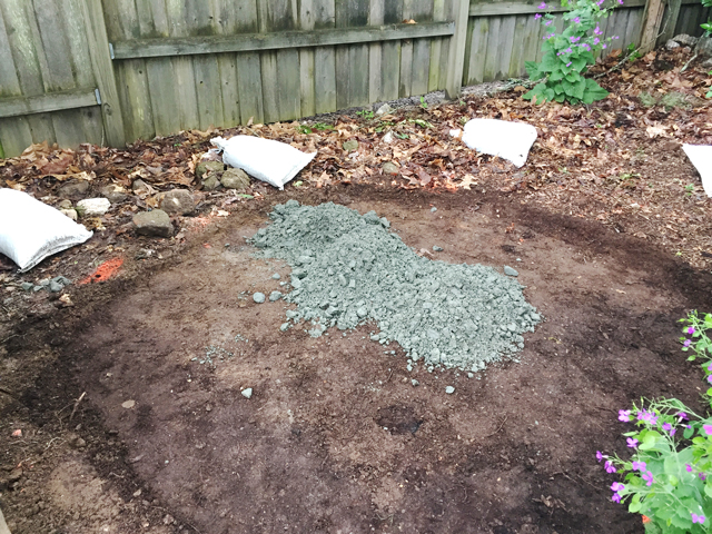 Granite gravel base is laid into area before leveling sand is added