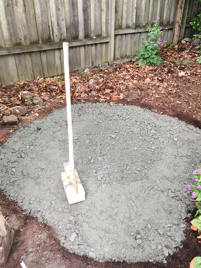 Granite base is tamped down to form hard base for sand and flagstones