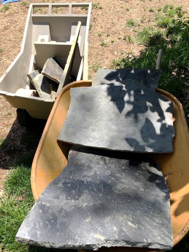 2 large gray flagstones in wheelbarrow
