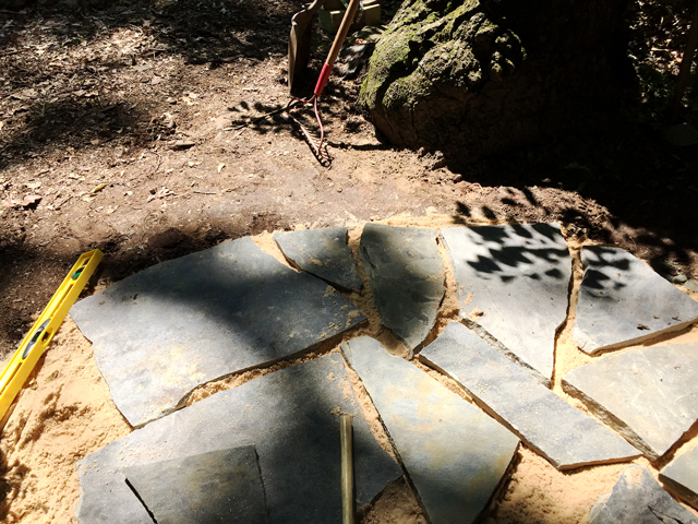 flagstones laid out on sand with minimum gaps between stones