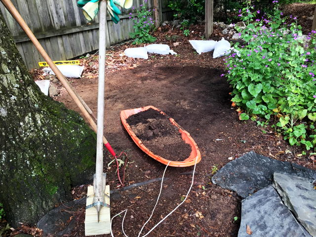 Removing excess soil from area