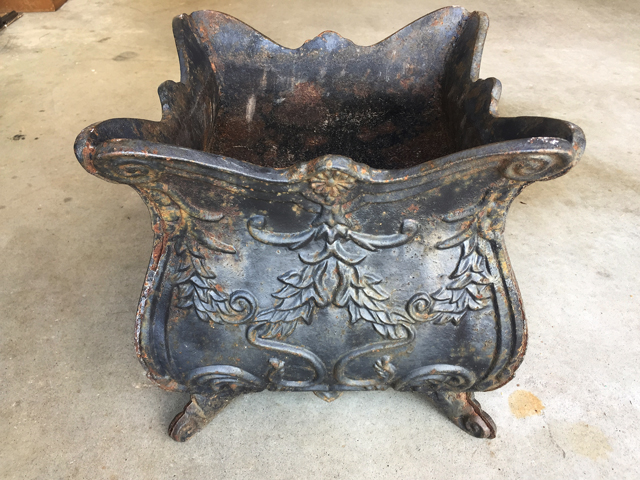 rusty and dirty iron planter in need of repair