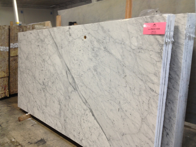 large slab of white marble with heavy pattern of gray veins