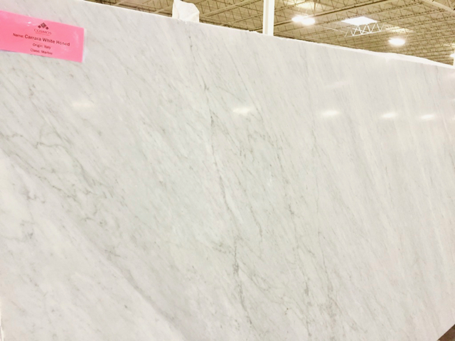 large slab of very light white marble with gray veining