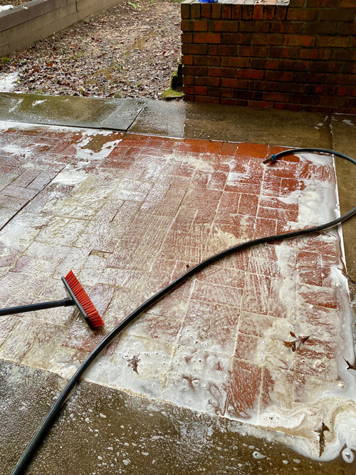 soap foam on patio during cleaning process