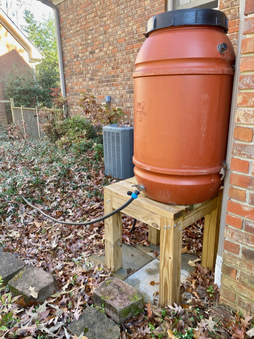 Connected Rain barrel on stand in outdoors