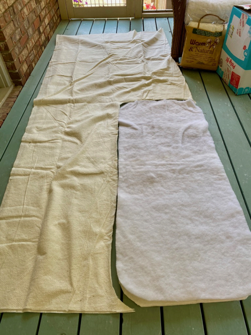 Old pattern lays on new batting for cutting